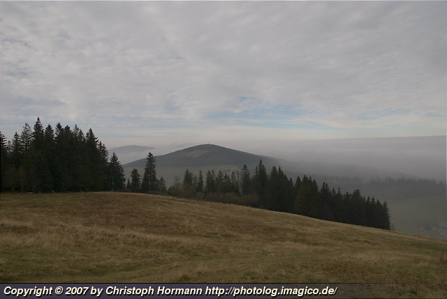 image 8: Fog in the southern Black Forest with the Hochfarn (center) and the Schauinsland (left behind) being visible above it